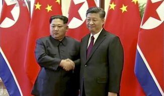 In this image taken from video footage run Wednesday, March 28, 2018, by China's CCTV via AP Video,  North Korean leader Kim Jong Un, left, and Chinese President Xi Jinping shake hands in Beijing, China. The Chinese government confirmed Wednesday that North Korea's reclusive leader Kim went to Beijing and met with Chinese President Xi in his first known trip to a foreign country since he took power in 2011. The official Xinhua News Agency said Kim made an unofficial visit to China from Sunday to Wednesday. (CCTV via AP Video)
