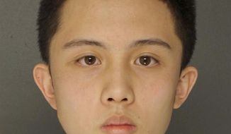 This undated photo provided by the Upper Darby Police Department in Upper Darby, Pa., shows An Tso Sun, a Taiwanese exchange student charged with making terroristic threats after he was arrested for threatening a shooting at his high school, Monsignor Bonner and Archbishop Prendergast Catholic High School in Drexel Hill, Pa. Police said Wednesday, March 28, 2018, that Sun had researched how to buy weapons, and that a military-style ballistic vest, ammunition clip pouches, a high-powered crossbow and live ammunition were found in his bedroom in Lansdowne, Pa. Sun is in custody in Delaware County Prison in Thornton, Pa., in lieu of $100,000 bail. (Upper Darby Police Department via AP)