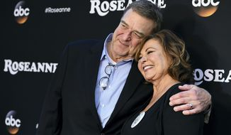 "John Goodman, left, and Roseanne Barr arrive at the Los Angeles premiere of ""Roseanne"" on Friday, March 23, 2018, in Burbank, Calif. (Photo by Jordan Strauss/Invision/AP)"