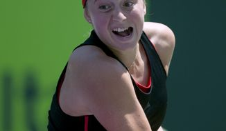 Jelena Ostapenko, of Latvia, hits a return against Elina Svitolina, of Ukraine, during the Miami Open tennis tournament Wednesday, March 28, 2018, in Key Biscayne, Fla. Ostapenko won 7-6 (3), 7-6 (5). (AP Photo/Gaston De Cardenas)