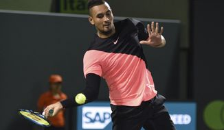 Nick Kyrgios, of Australia, returns a shot to Alexander Zverev, of Germany, during the Miami Open tennis tournament Tuesday, March 27, 2018, in Key Biscayne, Fla. Zverev won 6-4, 6-4. (AP Photo/Gaston De Cardenas) ** FILE **