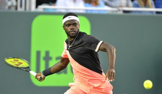 Frances Tiafoe, of the United States, returns a shot to Kevin Anderson, of South Africa, during the Miami Open tennis tournament Tuesday, March 27, 2018, in Key Biscayne, Fla. Anderson won 7-6 (3), 6-4. (AP Photo/Gaston De Cardenas) ** FILE **