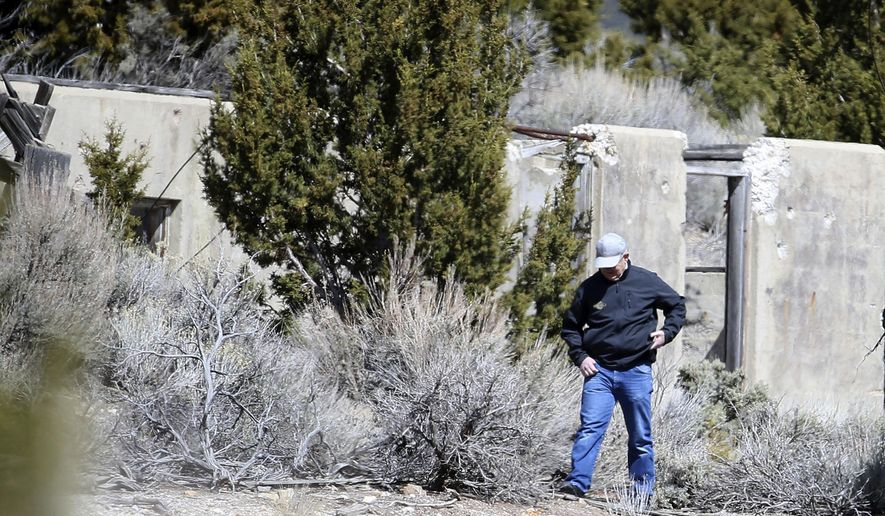 """Law enforcement officials investigate the scene where two bodies were discovered in an abandoned mine near Eureka, Utah, on Wednesday, March 28, 2018. Utah County sheriff's officials are recovering what they believe are the bodies of Riley Powell, 18, and his girlfriend, Brelynne """"Breezy"""" Otteson, 17. (Laura Seitz/The Deseret News via AP)"""