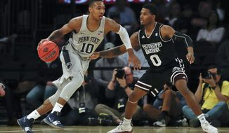 Penn State guard Tony Carr (10) drives against Mississippi State guard Nick Weatherspoon (0) during the second half of an NCAA college basketball game in the semifinals of the NIT, Tuesday, March 27, 2018, in New York. Penn State won 75-60. (AP Photo/Julie Jacobson)