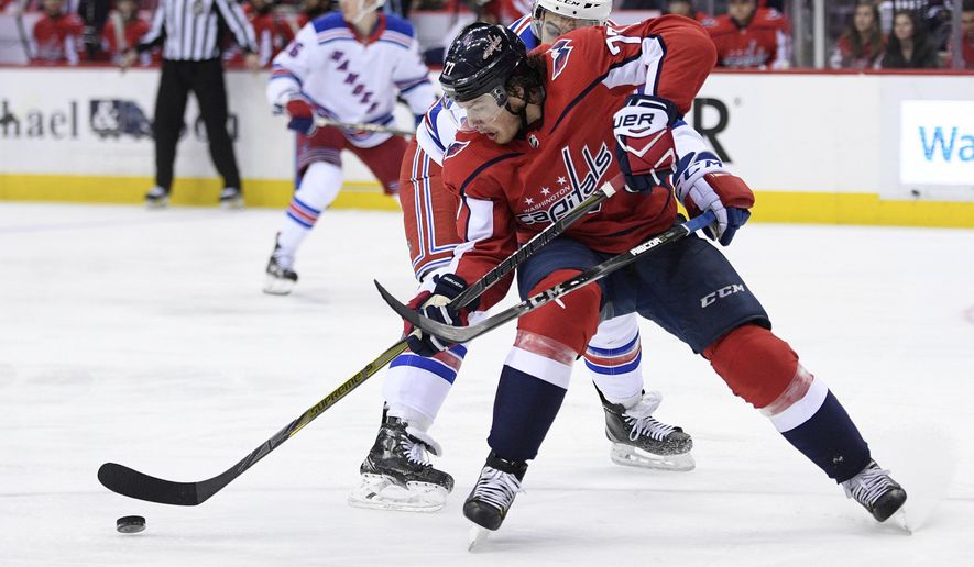 New York Rangers defenseman Ryan Sproul, rear, battles for the puck against Washington Capitals right wing T.J. Oshie (77) during the second period of an NHL hockey game Wednesday, March 28, 2018, in Washington. (AP Photo/Nick Wass) ** FILE **