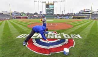 Kansas City Royals grounds crew manager Evan Fowler paints the Opening Day logo behind home plate, Wednesday, March 28, 2018, at Kauffman Stadium in Kansas City, Mo. The Royals open the baseball season on Thursday afternoon when they host the Chicago White Sox. (John Sleezer//The Kansas City Star via AP)