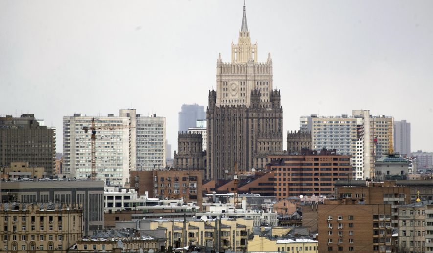 The building of the Russian Foreign Ministry, center, is seen in Moscow, Russia, Wednesday, March 28, 2018. More than 20 nations have expelled over 150 Russian diplomats this week in a show of solidarity with Britain over the poisoning of a former Russian spy and Moscow has pledged to retaliate. (AP Photo/Pavel Golovkin)