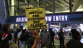 Demonstrators protesting the shooting death of Stephon Clark by Sacramento Police officers, block the entrance to the Golden 1 Center, preventing ticket holders who weren't already inside from watching the Dallas Mavericks play the Sacramento Kings in an NBA basketball game, Tuesday, March 27, 2018, in Sacramento, Calif. Clark, who was unarmed, was shot and killed a week earlier by two officers responding to a call about a person smashing car windows. (AP Photo/Rich Pedroncelli)
