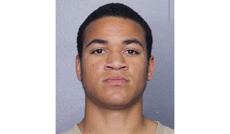 This undated, file photo released by the Broward Sheriff's Office shows Zachary Cruz. The brother of the suspected Florida high school gunman was scheduled to be in court for reconsideration of his $500,000 bail on a trespassing charge. (Broward Sheriff's Office via AP, File)