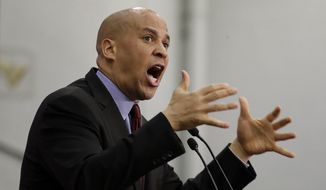 U.S. Sen. Cory Booker speaks during an event kicking off U.S. Sen. Bob Menendez's campaign for re-election at Union City High School, Wednesday, March 28, 2018, in Union City, N.J. (AP Photo/Julio Cortez) ** FILE **