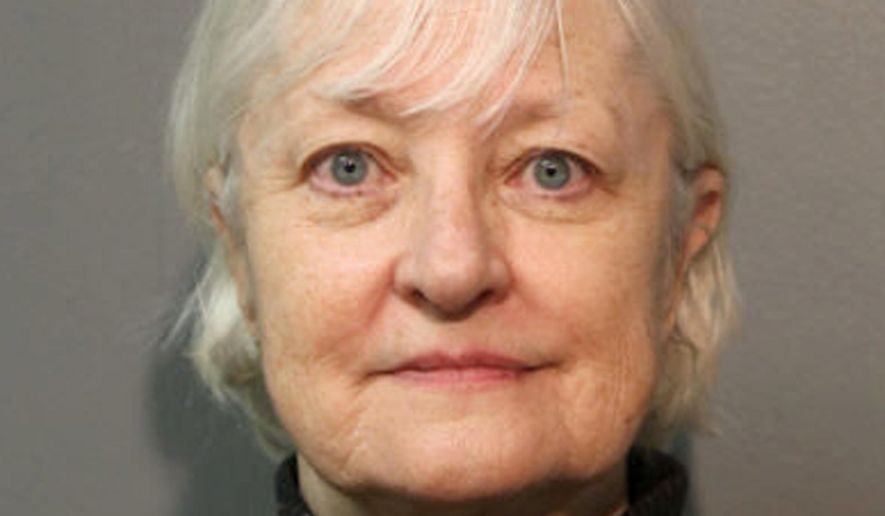FILE - This January 2018, file photo provided by the Chicago Police Department shows Marilyn Hartman. Hartman, who authorities say is a serial stowaway and recently sneaked onto a plane in Chicago, to London, has the local judicial system struggling as to what to do with her. Hartman is due back in court this week and the central question for the judge is what to do about a woman who's repeatedly tried to board commercial flights without a ticket. (Chicago Police Department via AP)