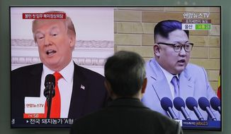FILE - In this March 27, 2018 file photo, A man watches a TV screen showing file footages of U.S. President Donald Trump, left, and North Korean leader Kim Jong Un, right, during a news program at the Seoul Railway Station in Seoul, South Korea. Increased activity at a North Korean nuclear site has once again caught the attention of analysts and renewed concerns about the complexities of denuclearization talks as President Donald Trump prepares for a summit with Kim Jong Un. (AP Photo/Lee Jin-man, File)