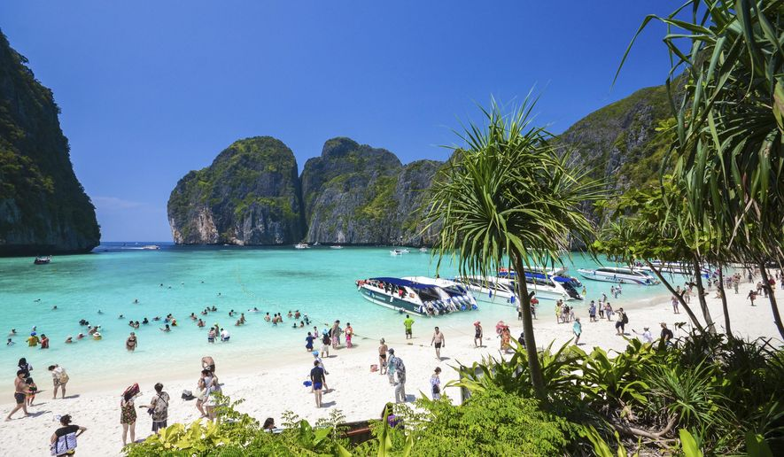 "In this March 4, 2017, photo, tourists enjoy the popular Maya bay on Phi Phi island, Krabi province. Authorities have ordered the temporary closing of the beach made famous by the Leonardo DiCaprio movie ""The Beach"" to halt environmental damage caused by too many tourists. (AP Photo/Rajavi Omanee)"