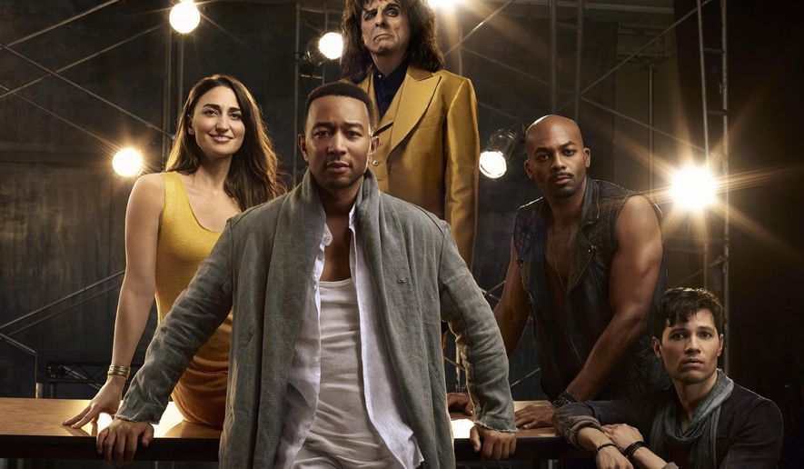 "This image released by NBC shows, clockwise from foreground center, John Legend as Jesus Christ, Sara Bareilles as Mary Magdalene, Alice Cooper as King Herod, Brandon Victor Dixon as Judas Iscariot and Jason Tam as Peter from the NBC production, ""Jesus Christ Superstar Live In Concert,"" airing April 1. (James Dimmock/NBC via AP)"