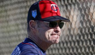 FILE - In this Feb. 17, 2018 photo Minnesota Twins manager Paul Molitor watches his players during baseball spring training in Fort Myers, Fla. The Twins worked hard this offseason to enhance the roster of a team that reached the playoffs in 2017. One key addition was right-hander Jake Odorizzi, who starts Thursday, March 29, 2018 in the opener against the Baltimore Orioles. (AP Photo/John Minchillo)