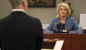 Elaine Wynn, ex-wife of Steve Wynn, listens during a hearing Wednesday, March 28, 2018, in Las Vegas. Elaine Wynn has accused her ex-husband and others of getting her off the company's board of directors in 2015 because of her inquiries into company activities. She has claimed that she was not re-nominated to be a board member that year as a result of retaliation. (AP Photo/John Locher)