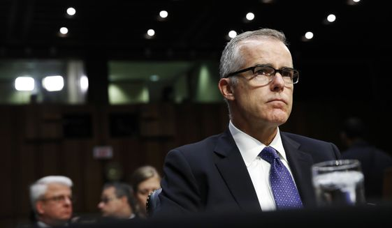 Acting FBI Director Andrew McCabe listens on Capitol Hill in Washington, Thursday, May 11, 2017, during the Senate Intelligence Committee hearing on major threats facing the U.S. (AP Photo/Jacquelyn Martin)