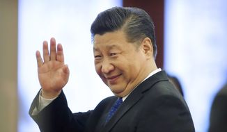 Chinese President Xi Jinping waves as he leaves a welcome ceremony at the Great Hall of the People in Beijing, Thursday, March 29, 2018. (AP Photo/Mark Schiefelbein) ** FILE **