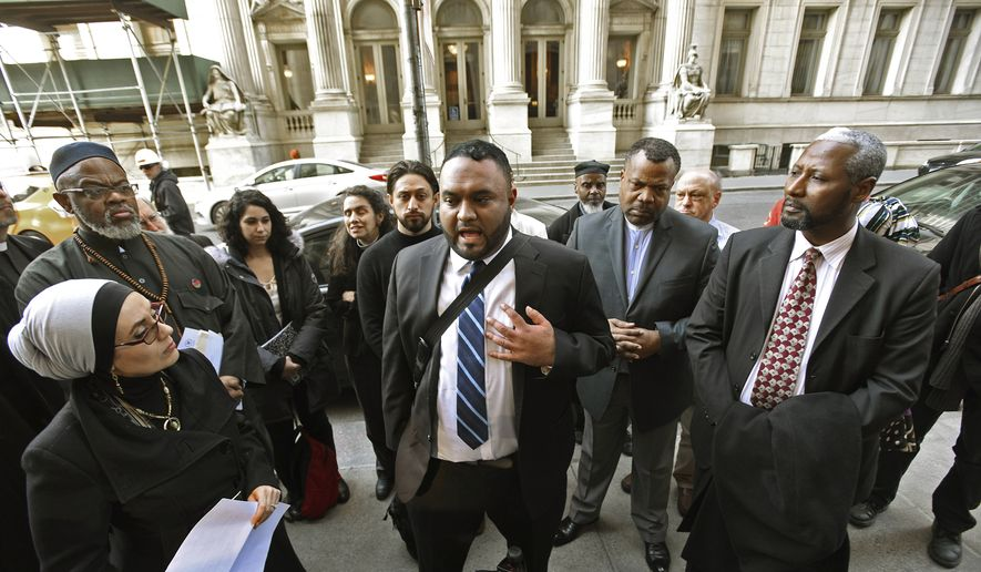 "FILE - In this March 8, 2016 file photo, Samir Hashmi, center, and community leaders hold a news conference in New York after oral arguments heard in court in a lawsuit by Hashmi challenging the New York Police Department's use of a Cold War-era legal tactic to conceal whether it put Hashmi and another Muslim man under surveillance. The state's highest court ruled Thursday, March 29, 2018 that the NYPD was within its rights to ""neither confirm nor deny"" the records pertaining to possible surveillance of Talib Abdur-Rashid, a Manhattan imam, and Hashmi, a former Rutgers University student even existed. (Viorel Florescu/The Record of Bergen County via AP, File)"