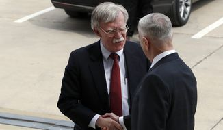 President Donald Trump's pick for national security adviser John Bolton, left, shakes hands with Defense Secretary Jim Mattis, as Bolton arrives at the Pentagon, Thursday, March 29, 2018, in Washington. (AP Photo/Alex Brandon) ** FILE **