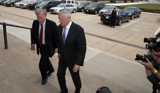 President Donald Trump's pick for national security adviser John Bolton, left, walks up the steps with Defense Secretary Jim Mattis, as Bolton arrives at the Pentagon, Thursday, March 29, 2018, in Washington. (AP Photo/Alex Brandon)