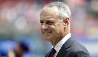 Baseball Commissioner Rob Manfred participates in a pregame ceremony before the opening day baseball game between the Houston Astros and Texas Rangers in Arlington, Texas, Thursday, March 29, 2018. (AP Photo/Tony Gutierrez)