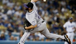 FILE - In this Sept. 8, 2017, file photo, Colorado Rockies relief pitcher Greg Holland throws to the plate against the Los Angeles Dodgers during the ninth inning of a baseball game in Los Angeles. A person familiar with the deal says All-Star closer Greg Holland and the St. Louis Cardinals have agreed to a $14 million, one-year contract.The person spoke on condition of anonymity Thursday, March 29, 2018, because the agreement was pending a physical and had not been announced.(AP Photo/Alex Gallardo, File)