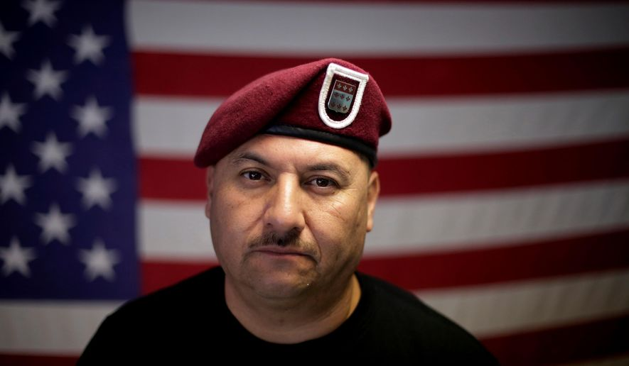 """FILE - In this Feb. 13, 2017, file photo, U.S. Army veteran Hector Barajas, who was deported, poses for a portrait in his office at the Deported Veterans Support House, nicknamed """"the bunker"""" in Tijuana, Mexico. Despite the pain of separation, many deported vets say they wouldn't hesitate to serve again if given the chance. """"Where do I sign up?"""" said Barajas. Deported U.S. Army veteran Barajas is getting U.S. citizenship after California Gov. Jerry Brown pardoned him for a criminal offense and he sued to regain permission to live in the United States. Lawyers for Barajas say they were told Thursday, March 29, 2018, their client should attend a naturalization ceremony on April 13. Barajas is prominent advocate for deported veterans. (AP Photo/Gregory Bull, File)"""