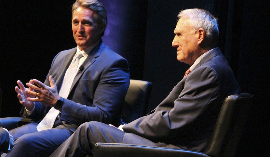 Sen. Jeff Flake, left, R-Ariz., and former Sen. Jon Kyl talk about the nature of politics and how bipartisanship is becoming more difficult, during a lecture at Arizona State University's Barrett Honors College in Tempe, Ariz., Wednesday, March 28, 2018. (AP Photo/Bob Christie)