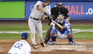 San Francisco Giants' Joe Panik, second from left, hits a solo home run as Los Angeles Dodgers starting pitcher Clayton Kershaw, left, watches along with catcher Yasmani Grandal, right, and home plate umpire Mark Wegner, top right, during the fifth inning of an opening day baseball game Thursday, March 29, 2018, in Los Angeles. (AP Photo/Mark J. Terrill)