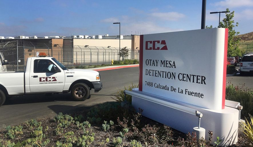 A vehicle drives into the Otay Mesa detention center in San Diego, Calif. (AP Photo/Elliot Spagat, File)