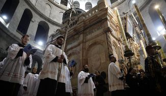 Catholic clergy walk during the Washing of the Feet procession at the Church of the Holy Sepulchre, traditionally believed by many Christians to be the site of the crucifixion and burial of Jesus Christ, in Jerusalem, Thursday, March 29, 2018. (AP Photo/Mahmoud Illean)