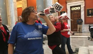 """Retired teacher Lydia Coffey chants """"Vote them out"""" as lawmakers in Kentucky debate a bill to make changes to the state's pension system on Thursday, March 29, 2018, in Frankfort, Kentucky. (AP Photo/Adam Beam)"""