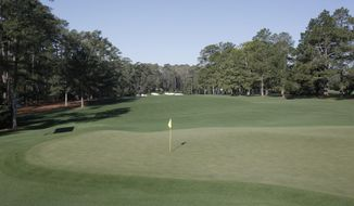 This March 31, 2010 photo shows the green on the 14th hole at Augusta National Golf Club, the site of the Masters golf tournament in Augusta, Ga. The hole can be a pivotal part of a Sunday charge at the Masters. (AP Photo/Rob Carr)