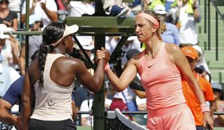 Sloane Stephens, left, shakes hands with Victoria Azarenka, of Belarus, after Stephens' 3-6, 6-2, 6-1 win in their semifinal match in the Miami Open tennis tournament, Thursday, March 29, 2018, in Key Biscayne, Fla. (AP Photo/Joe Skipper)  **FILE**