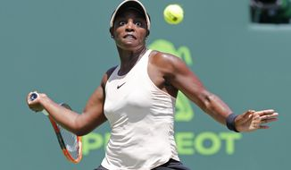 Sloane Stephens returns the ball to Victoria Azarenka, of Belarus, during their semifinal match in the Miami Open tennis tournament, Thursday, March 29, 2018, in Key Biscayne, Fla. (AP Photo/Joe Skipper)