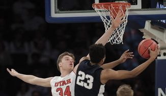 Penn State guard Josh Reaves (23) shoots next to Utah forward Jayce Johnson (34) in the first quarter of an NCAA college basketball game for the NIT championship Thursday, March 29, 2018, in New York. (AP Photo/Julie Jacobson)