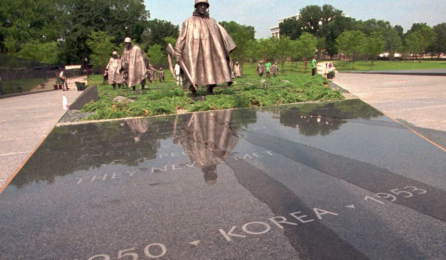 FILE - This July 27, 1995 file photo shows the statues at the Korean War Veterans Memorial in Washington, D.C.   (AP Photo/Marcy Nighswander, File)