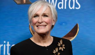 FILE - In this Feb. 11, 2018 file photo, actress Glenn Close poses at the 2018 Writers Guild Awards in Beverly Hills, Calif. The Emmy- and Tony-award-winning actress is in Ann Arbor, Michigan, for a gathering designed to bring awareness to efforts aimed at reducing the stigma surrounding mental illness. (Photo by Chris Pizzello/Invision/AP, File)