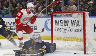 Detroit Red Wings forward Darren Helm (43) puts the puck past Buffalo Sabres goalie Robin Lehner (40) during the second period of an NHL hockey game Thursday, March 29, 2018, in Buffalo, N.Y. (AP Photo/Jeffrey T. Barnes)