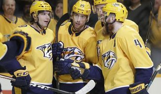 Nashville Predators right wing Craig Smith (15) is congratulated after scoring a goal against the San Jose Sharks in the second period of an NHL hockey game Thursday, March 29, 2018, in Nashville, Tenn. (AP Photo/Mark Humphrey)