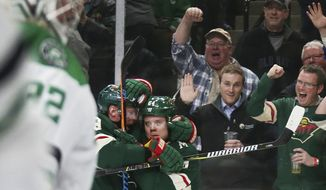 Minnesota Wild right wing Mikael Granlund is congratulated by Mikko Koivu (9) after scoring on Dallas Stars goalie Kari Lehtonen (32) during the first period of an NHL hockey game Thursday, March 29, 2018, in St. Paul, Minn. (AP Photo/Andy Clayton-King)