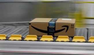 In this Feb. 9, 2018, file photo, a box for an Amazon prime customer moves through the new Amazon Fulfillment Center in Sacramento, Calif. (AP Photo/Rich Pedroncelli) ** FILE **
