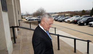 Defense Secretary Jim Mattis, walks to greet President Donald Trump's pick for national security adviser John Bolton, right, as Bolton arrives at the Pentagon, Thursday, March 29, 2018, in Washington. (AP Photo/Alex Brandon)
