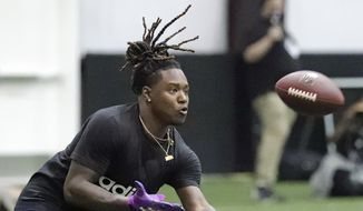 Central Florida's Shaquem Griffin catches a pass during a drill at UCF's Pro Day, Thursday, March 29, 2018, in Orlando, Fla. Pro day is intended to showcase talent to NFL scouts for the upcoming draft.  (AP Photo/John Raoux) ** FILE **