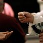 A Eucharistic Minister serves communion during Mass at a Catholic church in Caracas, Venezuela, on May 29, 2013. (Associated Press) **FILE**