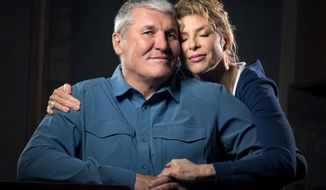 In this Monday March 26, 2018 photo, former Super Bowl MVP and Shadle Park High graduate Mark Rypien poses with his wife Danielle, in Spokane, Wash. With the help of his wife Rypien is dealing with a traumatic brain injury caused by the many concussions he received during his football career. (Colin Mulvany /The Spokesman-Review via AP)