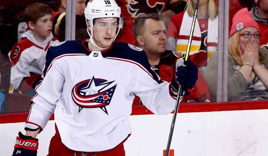Columbus Blue Jackets center Pierre-Luc Dubois (18) celebrates his goal against the Calgary Flames during the third period of an NHL hockey game Thursday, March 29, 2018, in Calgary, Alberta. (Larry MacDougal/The Canadian Press via AP)