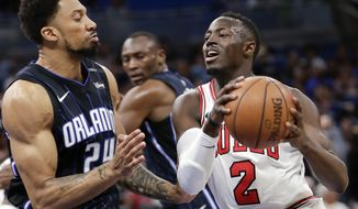 Chicago Bulls' Jerian Grant (2) goes to the basket against Orlando Magic's Khem Birch (24) during the first half of an NBA basketball game, Friday, March 30, 2018, in Orlando, Fla. (AP Photo/John Raoux)