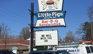 """In this March 23, 2018 photo, a sign reading """"We Will Miss You Joe"""" is displayed outside Little Pigs BBQ in Asheville, N.C. Founder Joe Swicegood died March 22. (Mackensy Lunsford /The Asheville Citizen-Times via AP)"""